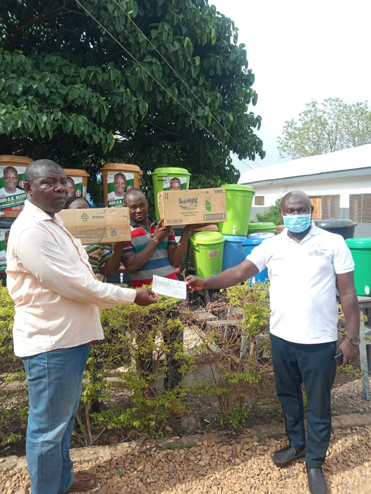 John Oti Bless Presents Cheque of Ghc10,000 To Nkwanta North For Training Of Health Committee And Tracing Of Returnees From Accra And Kumasi Due To Lockdown